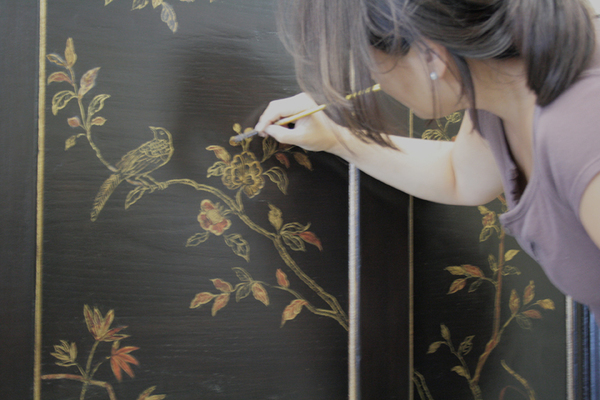 Hand painting chinoiserie details on furniture